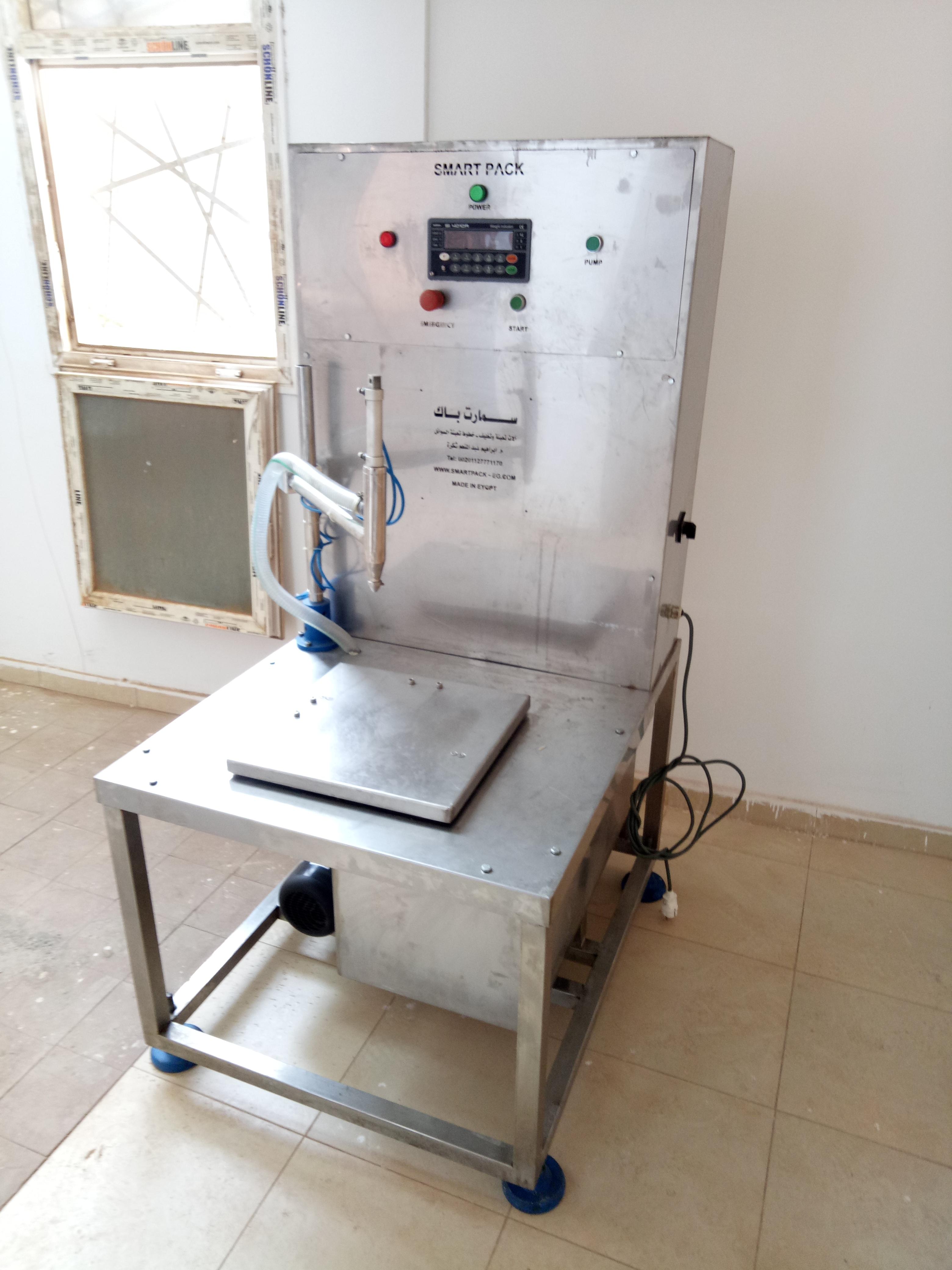 مكنة تعبئة سوائل وزنية - جراكن - صفيح